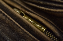 macro photo of harley davidson leather jacket zipper