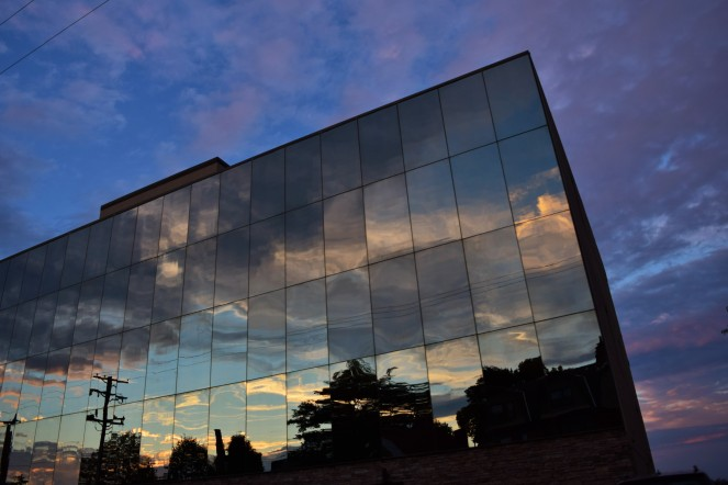 reflection of sunset and clouds in windows