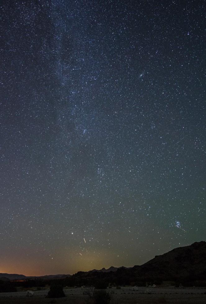 Milky Way Andromeda galaxy pleiades California desert rock formations mountains