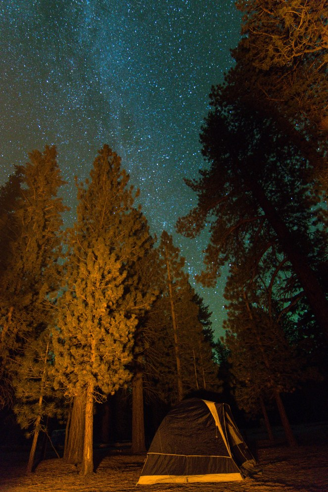 The Milky Way shines over Inyo National Forest near June Lake and Obsidian Dome. Milky Way galaxy. Stars. Starry Sky. Tent camp. Tent camping. Outdoors.