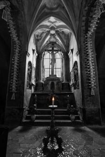 sedlec ossuary bone church cross of christ lit candle skulls skull and bones