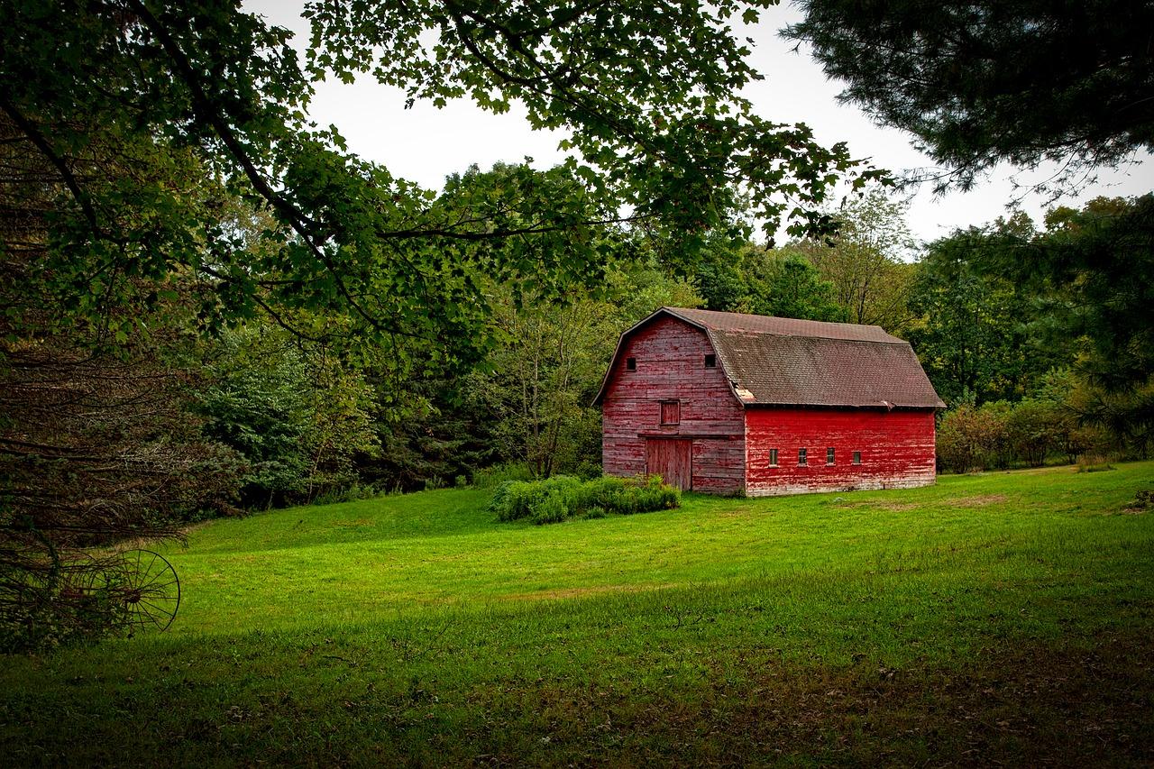 red barn trees shrubs farmland antique plough plow