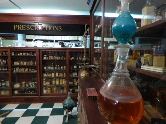 oil lamp prescriptions old antique glass lamp glass vials wooden shelves glass display cases