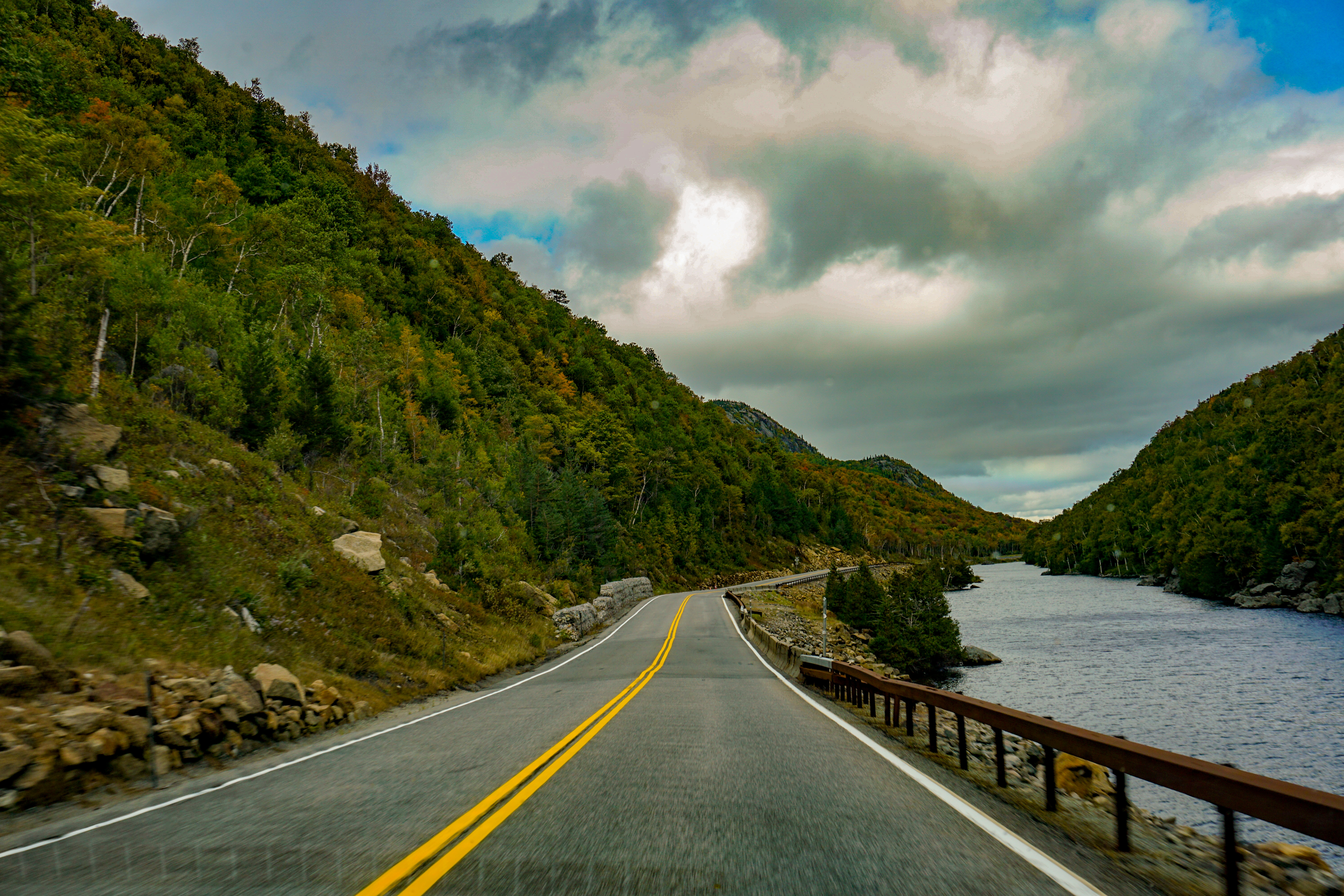 Fall colors and blue sky over NY Route 73 along Lower Cascade Lake