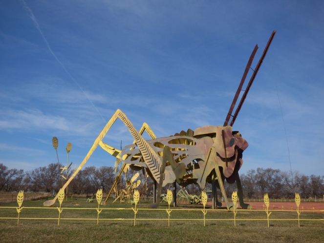 scrap metal grasshopper statue roadside attraction kitsch americana grasshoppers in the field north dakota enchanted highway